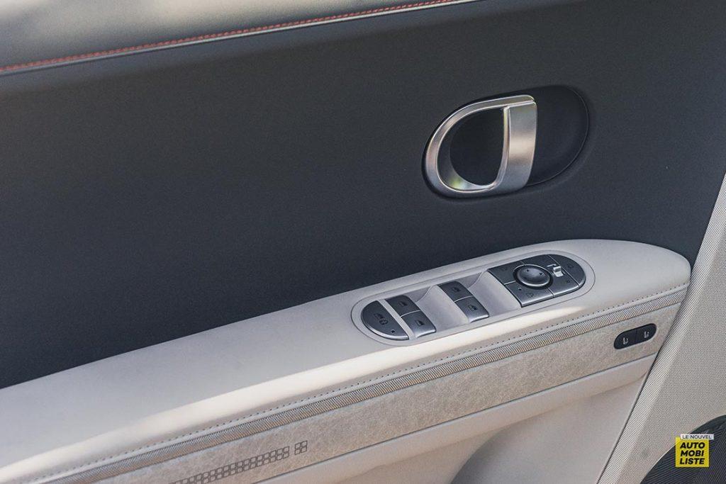 Essai Hyundai Ioniq 5 HTRAC Executive 73kW Digital Teal Green Contre porte qualite